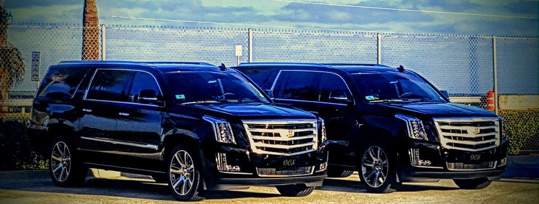Two Escalades at Port Canaveral providing transportation.